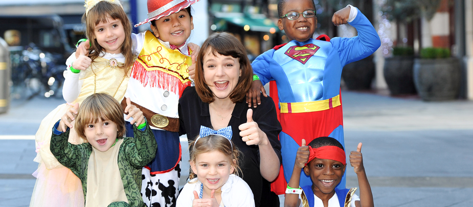 Carey Mulligan with school children dressed up with thumbs up at Into Film festival