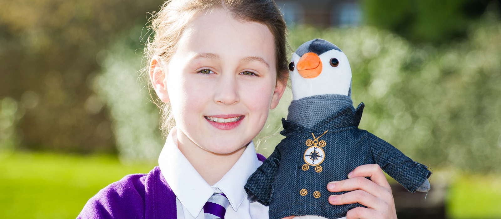 Young girl holding British Gas toy